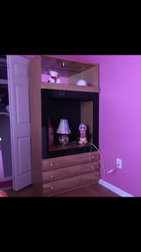 brown wooden TV hutch with flat screen television Germantown
