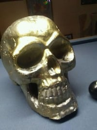 gold-colored skull table decor