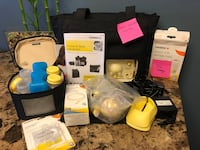 Medela Breast Pump with lots of extras.
