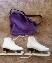 pair of white ice skates and purple duffle bag Crete, 60417