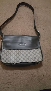 monogrammed brown and black Gucci leather crossbody bag