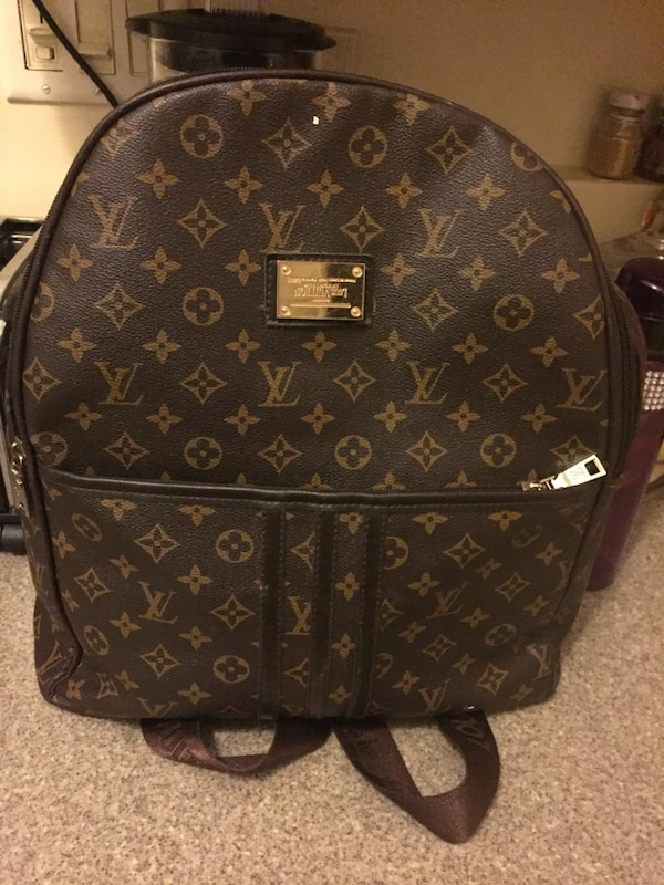 Used Louis Vuitton Bags >> Louis Vuitton Backpack Brown
