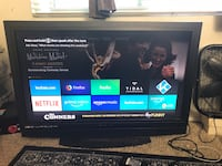 Black flat screen tv with remote 2219 mi