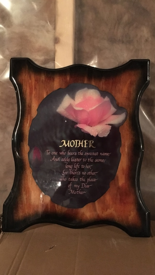Brown wooden board with mother quote board