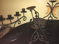 assorted black metal candle holders