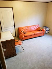 1970s orange leather sofa bed and matching chair