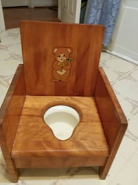 brown wooden vintage potty chair