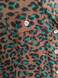 Turquoise and brown cheetah print button up shirt. Size M Oklahoma City