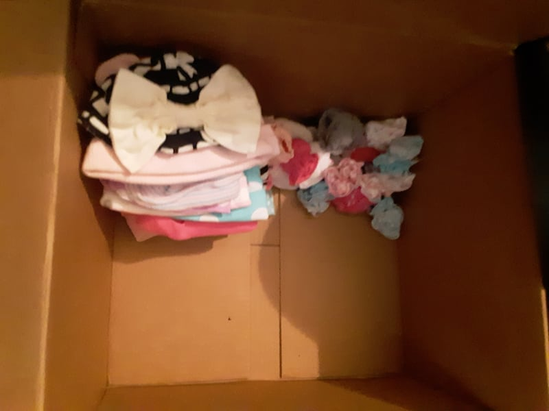Box of baby clothes 5e01499e-4d76-4729-848b-45bc6bfa570f