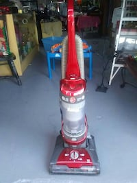 red Hoover upright vacuum cleaner