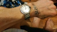 round silver-colored analog watch with link bracelet London, N5W 2X5