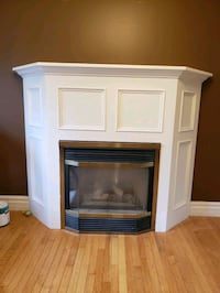 Gas fireplace and wooden surround Guelph, N1H 8B7