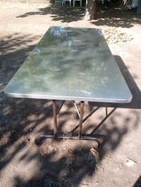 Stainless table cover with table
