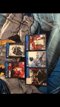 Five assorted ps4 game cases Moriarty, 87035