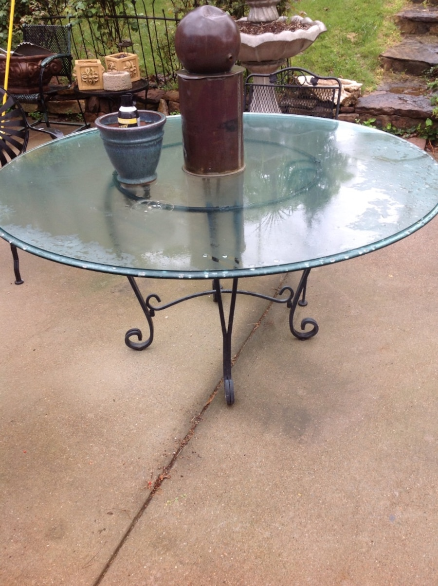 Used black steel scroll framed round glass top patio table for Table th no scroll
