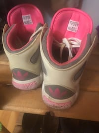 pair of white-and-pink Nike basketball shoes Surrey
