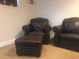 Brown faux leather sofa, chair, love seat and ottoman and console.