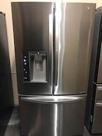 2015 MODEL LG DOOR IN DOOR STAINLESS STEEL REFRIGERATOR WITH ICE MAKER AND WATER DISPENSER IN AMAZING CONDITION LIKE BRAND NEW Los Angeles, 90011
