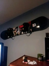 black and red snowboard with bindings East Patchogue, 11772