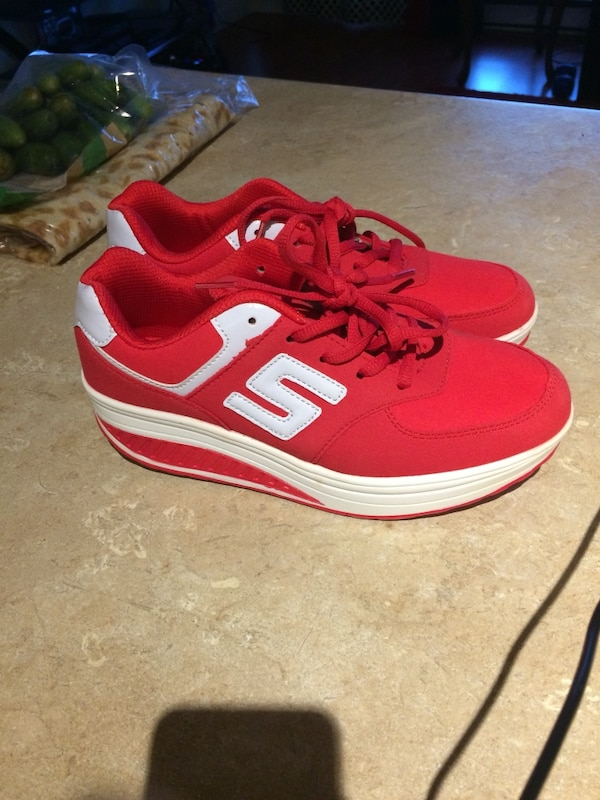 red-and-white New Balance running shoes