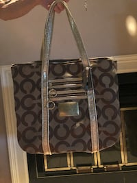 Genuine Coach handbag. I carried it twice. It's in excellent like new condition... no marks or stains. I'm trying to downsize my tons of handbags!! Lexington, 40515