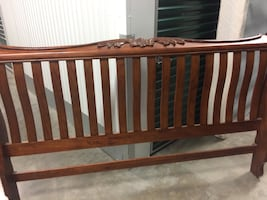 Bed frame King with everything included.  Head board foot board wood