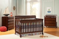 brown wooden sleigh crib, 4-drawers chest, and changing table