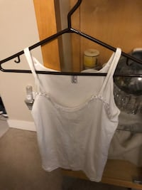 White and black undershirts 100% cotton fits small to medium asking $5 for both  Burnaby, V5E 0A4