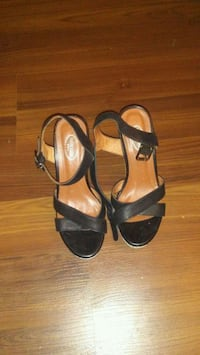 pair of black leather open-toe ankle strap heels Calgary