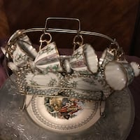 Mint condition vintage floral trim with gold and ornate with heart shape gold handle 12 piece cappuccino/ espresso set with metal rack. mint condition. Freeport, 11520