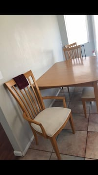 Rectangular brown wooden table with four chairs dining set Las Vegas, 89128