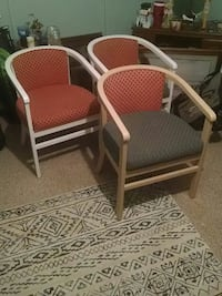 three brown fabric padded armchairs with white wooden bases