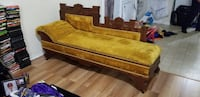brown wooden framed brown fabric padded sofa Columbia