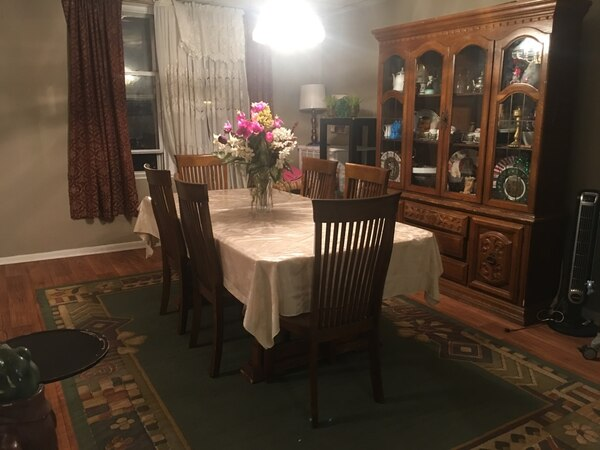 Brown wooden dining table set with armoire