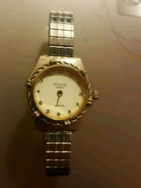 round gold analog watch with link bracelet Calgary, T2A 5L2
