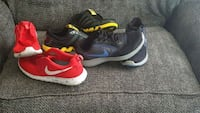 pair of black-and-red Nike running shoes Roswell, 88203