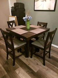 rectangular brown wooden table with four chairs dining set Calgary, T2Z 0V7