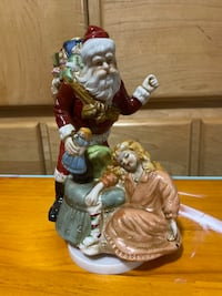 Ceramic/porcelain Santa musical figurine