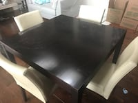 Rectangular black wooden table with four chairs dining set Aldergrove, V4W 1L4