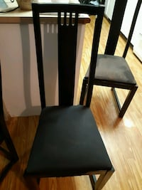 black round dining table with chairs