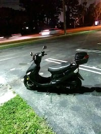Black scooter 776 miles Free Delivery Miami Gardens
