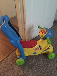 Toddler's blue, red, and yellow push trike