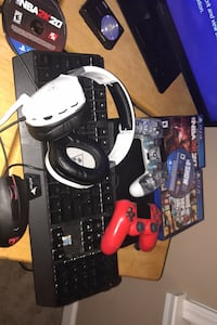 PS4 with games and controllers and mic and keyboard and a mouse