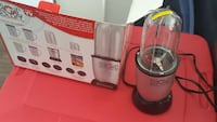 black and silver Magic Bullet blender with box
