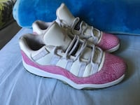 pair of pink-and-white Adidas running shoes Boston, 02163