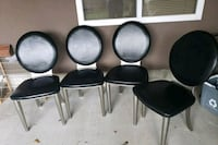 4 black and silver chairs Surrey, V3W 2W4