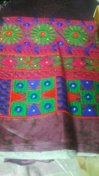 red, green, and blue floral textile Kolkata, 700023