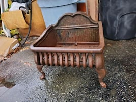 Antique fireplace log holder