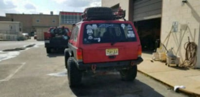 red Jeep Cherokee SUV