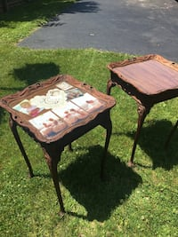 2 end tables  Appox 75 to 80 yrs old.  Thick glass tops.  Very beautiful.  I loved the change of seasons to decorate the tops.  Christmas is fun!  You could also put thin keepsakes! Tonawanda, 14150